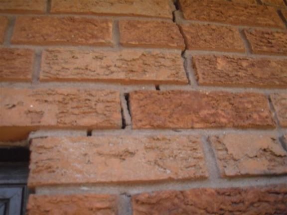 This is a typical crack in the bricks near a garage door.