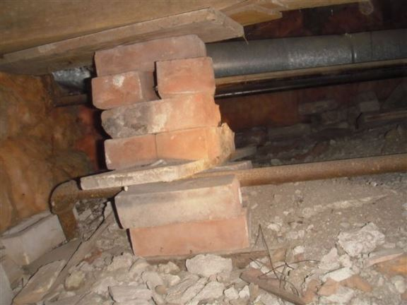 This is a common improper support pillar found in crawl spaces.