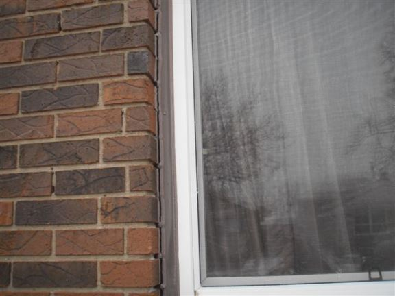 Window and door caulking is required on this house to reduce heating costs and prevent water leakage.