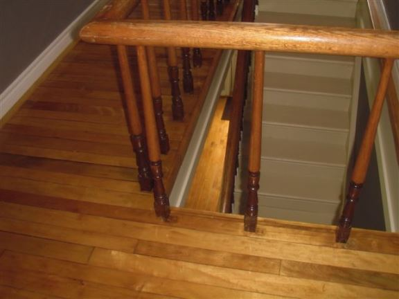 This photo shows that the stair spindle spaces that are too wide for toddlers – a very dangerous situation.