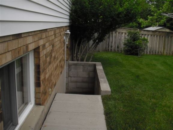 With no guard rails on this basement walk-out there is a fall hazard and risk of a law suit.