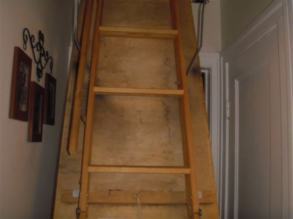 This attic stairway is convenient but seals poorly and should be insulated.