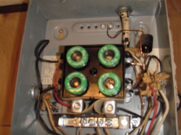 The wires used here are rated for 15 amp fuses but they feed into a 30 amp breaker.